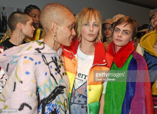 Adwoa Aboah Edie Campbell and Cara Delevingne wearing Burberry at the Burberry February 2018 show during London Fashion Week at Dimco Buildings on...