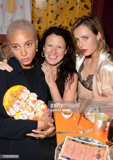 Adwoa Aboah Katie Grand and Edie Campbell attend the LOVE Magazine 10th birthday party with PerrierJouet at Loulou's on September 17 2018 in London...