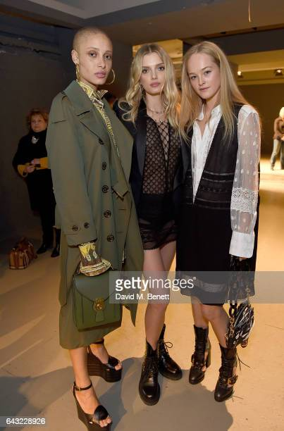 Adwoa Aboah Lily Donaldson and Jean Campbell wearing Burberry attend the Burberry February 2017 Show during London Fashion Week February 2017 at...