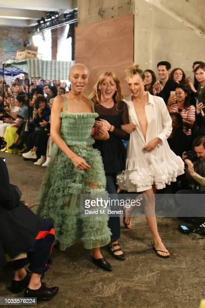 Adwoa Aboah Molly Goddard and Edie Campbell are seen on the runway at the Molly Goddard front row during London Fashion Week September 2018 on...