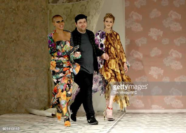 Adwoa Aboah, Richard Quinn and Jean Campbell walk the runway at the Richard Quinn show during London Fashion Week February 2018 at BFC Show Space on...
