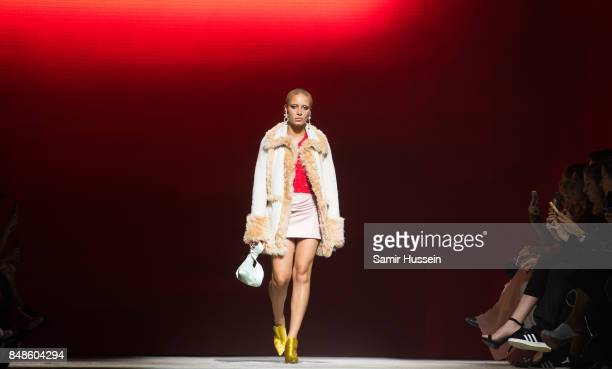 Adwoa Aboah walks the runway at the TOPSHOP show during London Fashion Week September 2017 on September 17 2017 in London England