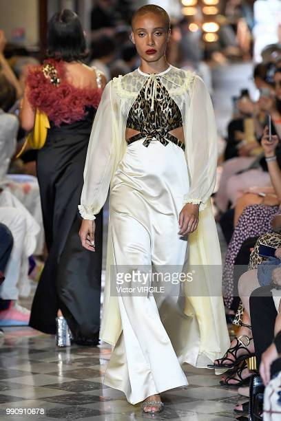 Adwoa Aboah walks the runway during the finale of the Miu Miu 2019 Cruise Collection Show at Hotel Regina on June 30 2018 in Paris France