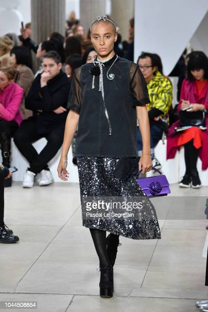 Adwoa Aboah walks the runway during the Miu Miu show as part of the Paris Fashion Week Womenswear Spring/Summer 2019 on October 2 2018 in Paris France