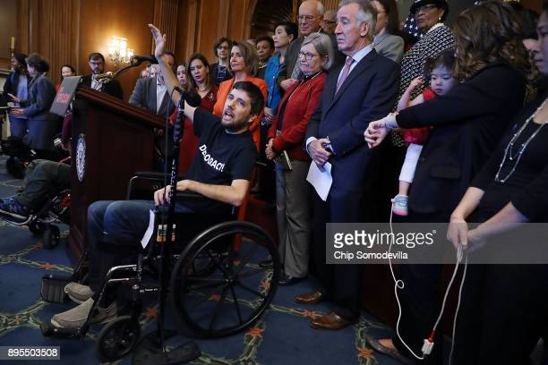 Ady Barkan who lives with Amyotrophic Lateral Sclerosis calls out Raise your hand if you think the richest people in America need more money during a...