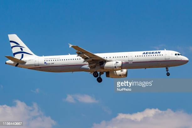 Aegean Airlines Airbus A321200 aircraft landing at Athens International Airport AIA Eleftherios Venizelos ATH / LGAV in a blue sky summer day on 15...