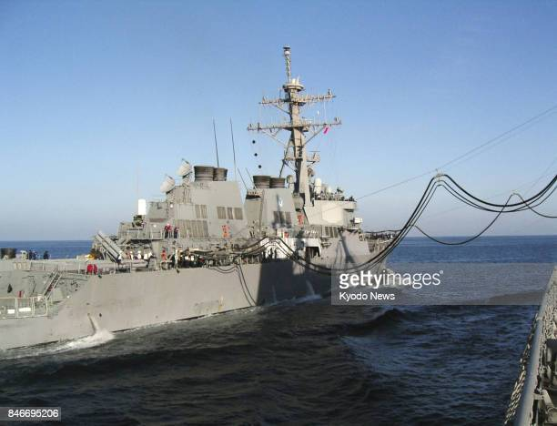 A US Aegis ship is refueled by a Japan Maritime SelfDefense Force oiler in this file photo taken on the Arabian Sea in March 2004 under special...