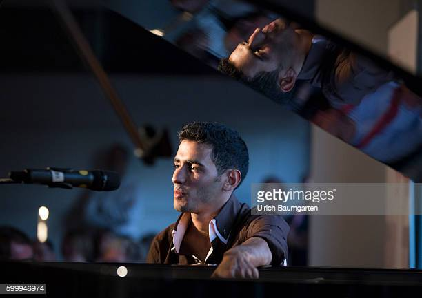 """Aeham Ahmad - """"The pianist in the rubble""""-. Aeham Ahmad despite war and distress in Syria with music. With his piano he moved trough the wreckage of..."""