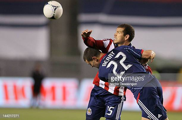 Aejandro Moreno of Chivas USA and Austin Berry of the Chicago Fire vie for the ball in the second half of the MLS match at The Home Depot Center on...