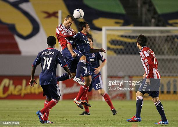 Aejandro Moreno of Chivas USA and Pavel Pardo of the Chicago Fire vie for the ball during the MLS match at The Home Depot Center on May 4 2012 in...