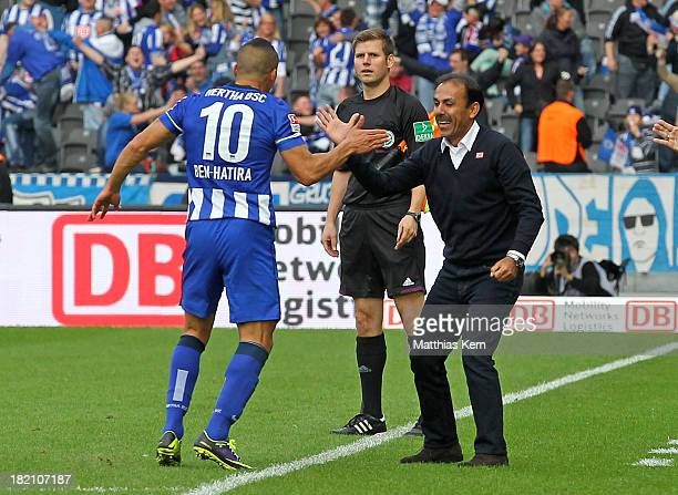 Aenis Ben Hatira of Berlin jubilates with head coach Jos Luhukay after scoring the fourth goal during the Bundesliga match between Hertha BSC and...