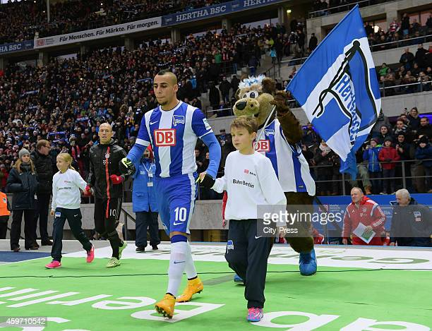 Aenis BenHatira and mascot Herthinho of Hertha BSC enter the pitch during the Bundesliga match between Hertha BSC and Bayern Muenchen at...