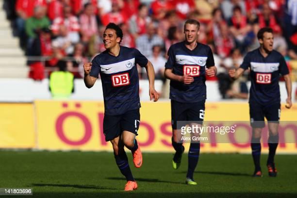 Aenis Ben-Hatira Felix Bastians and Christoph Janker of Berlin celebrate their team's first goal during the Bundesliga match between FSV Mainz 05 and...