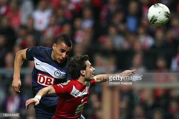 Aenis BenHatira of Berlin and Kevin Lehmann of Essen go up for ea header during the second round DFB Cup match between RotWeiss Essen and Hertha BSC...