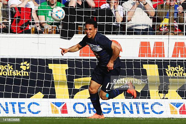 Aenis Ben-Hatira of Berlin celebrates his team's first goal during the Bundesliga match between FSV Mainz 05 and Hertha BSC Berlin at Coface Arena on...