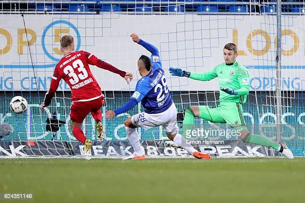 Aenis BenHatira of Darmstadt tries to score against Martin Hansen of Ingolstadt during the Bundesliga match between SV Darmstadt 98 and FC Ingolstadt...