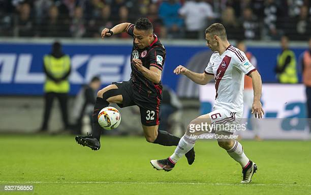 Aenis BenHatira of Eintracht Frankfurt challenges Laszlo Sepsi of Nuernberg during the bundesliga playoff between Eintracht Frankfurt and 1 FC...
