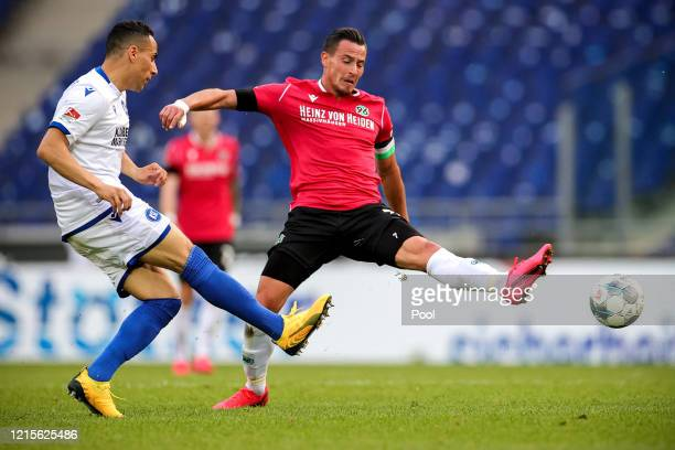 Aenis Ben-Hatira of Karlsruher SC and Edgar Prib of Hannover 96 battle for possession during the Second Bundesliga match between Hannover 96 and...