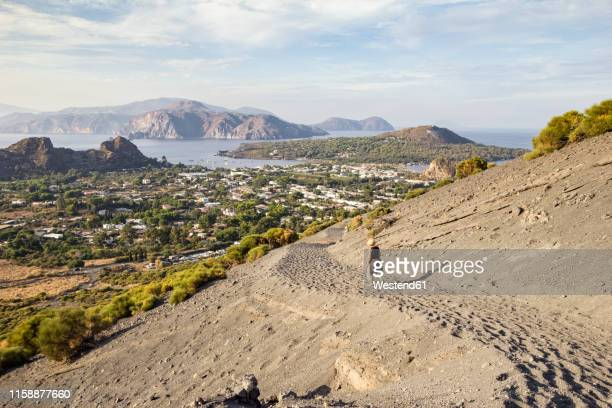 aeolian islands, vulcano, female senior hiker at volcano - sicily stock pictures, royalty-free photos & images