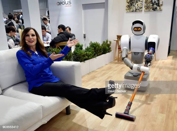 Aeolus representative Cindy Ferda demostrates the Aeolus Robot's abilities at the Aeolus booth during CES 2018 at the Las Vegas Convention Center on...