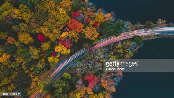 aerea view in the autumn of the road with passing cars - blue ridge parkway stock pictures, royalty-free photos & images