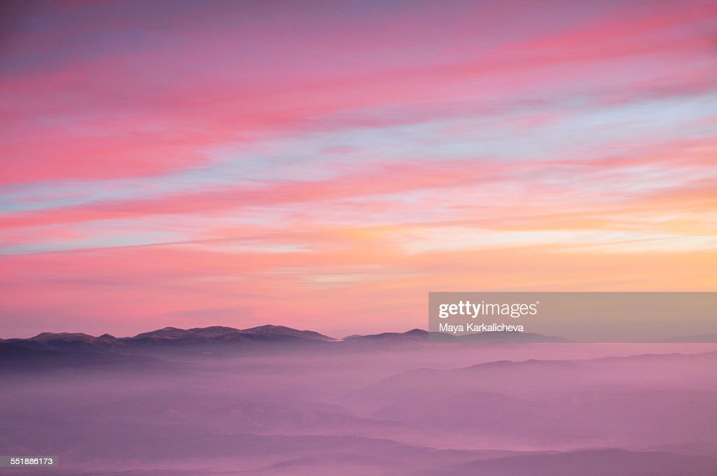 Aereal view of pink sunrise in a mountain : Stock Photo