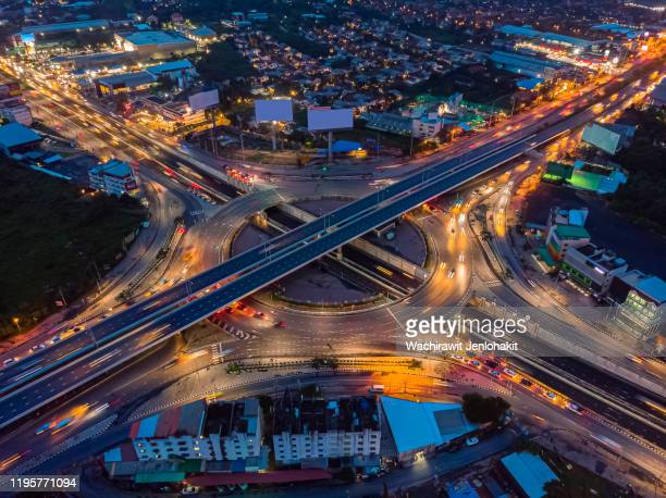 aeria view, highway road roundabout intersection or circle at night for transportation that facilitates the travel of car users on the road transportation or futuristic concept. - futuristic car stock pictures, royalty-free photos & images