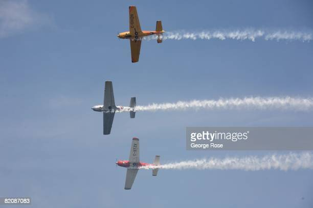 Aerial acrobatic planes fly overhead during Canada Day festivities in this 2008 Penticton British Columbia Canada summer photo Canada Day is the...