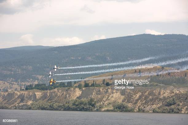 Aerial acrobatic planes fly overhead in formation during Canada Day festivities in this 2008 Penticton British Columbia Canada summer photo Canada...