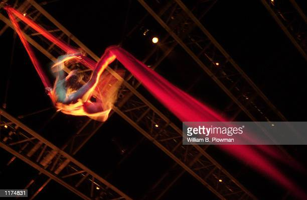 Aerial artist Isabelle Vaudelle hangs in a column of red silk during a dress rehearsal of Cirque du Soleil's show Quidam July 24 2002 in Boston...