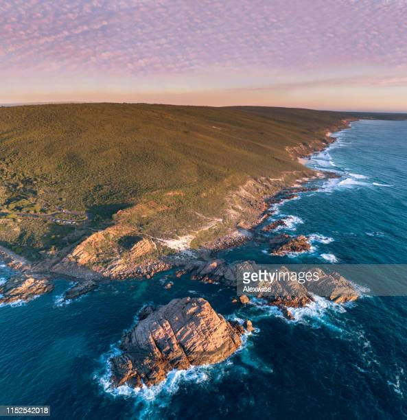 aerial at sugarloaf rock, western australia on sunset - international landmark stock pictures, royalty-free photos & images