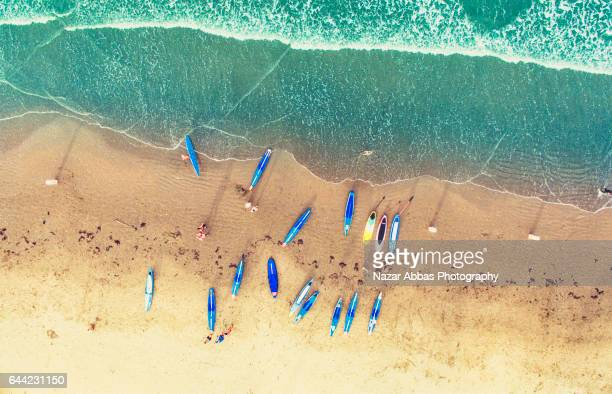 Aerial Background Of Kayaks At Orewa Beach.