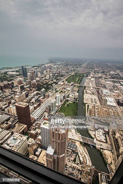 Aerial City View of the Extensive Metra Train Track Railway Public Transit Authority System and Bridges in Downtown Chicago Illinois as Viewed From...