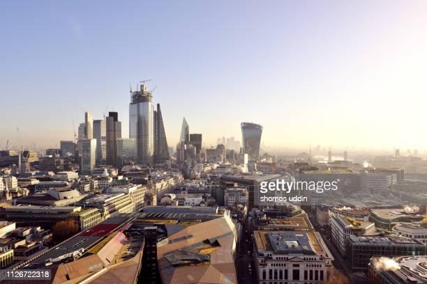 aerial cityscape of london city skyline at sunrise - london und umgebung stock-fotos und bilder
