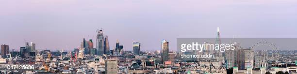 aerial cityscape of london skyline against sky at dusk - panoramic view - skyline stock pictures, royalty-free photos & images