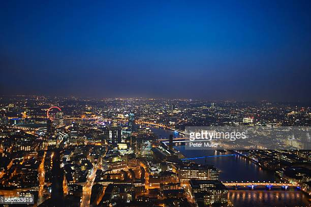 Aerial cityscape of river Thames at night, London, England, UK