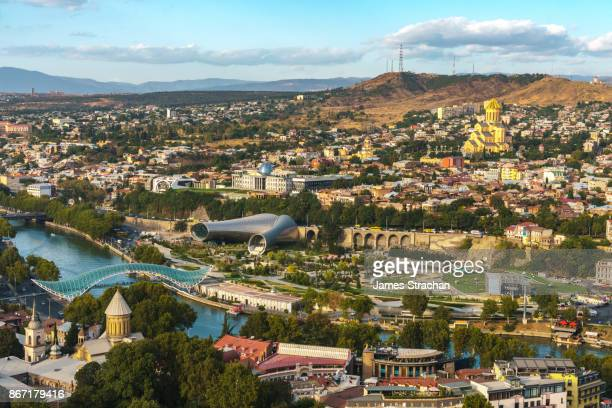 aerial cityscape of tbilisi in afternoon sun across the river, georgia - tbilisi stock pictures, royalty-free photos & images