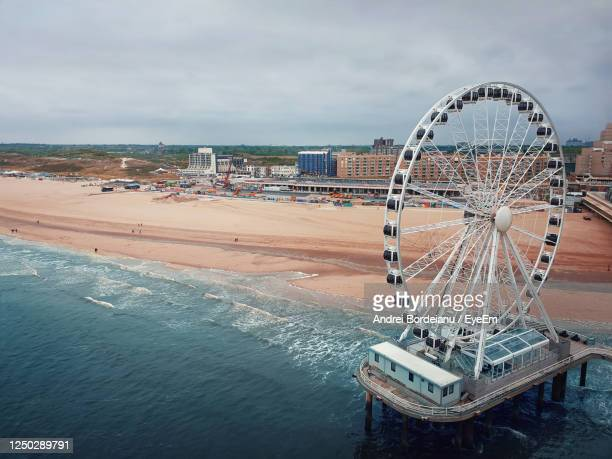 aerial cityscape of the ferris wheel and the de pier in hague, the netherlands. gloomy day - スヘフェニンゲン ストックフォトと画像