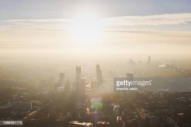 aerial cityscape over london city at sunset - smog stock pictures, royalty-free photos & images