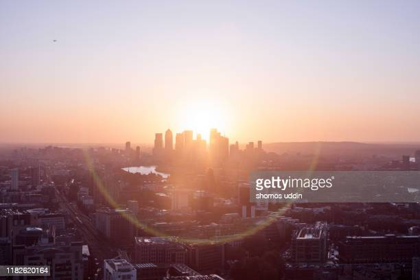 aerial cityscape over london city skyline at sunrise - morgendämmerung stock-fotos und bilder