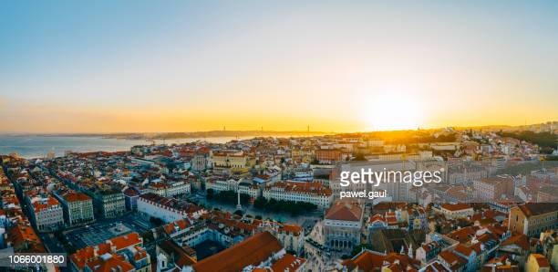 aerial cityscape panorama lisbon portugal sunset - lisbon stock pictures, royalty-free photos & images