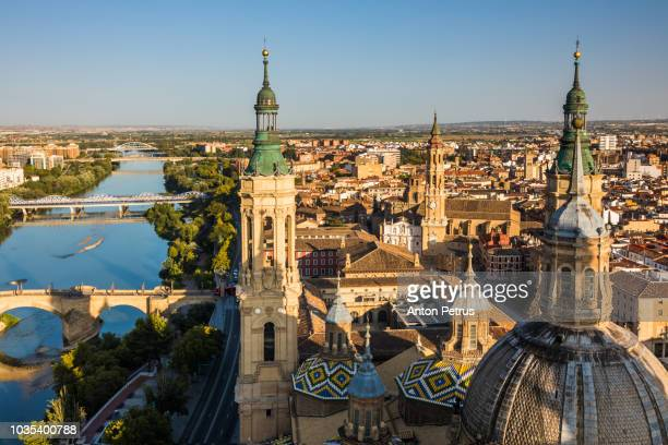 aerial cityscape view on the roofs and spires of basilica of our lady in zaragoza, spain - zaragoza city stock photos and pictures