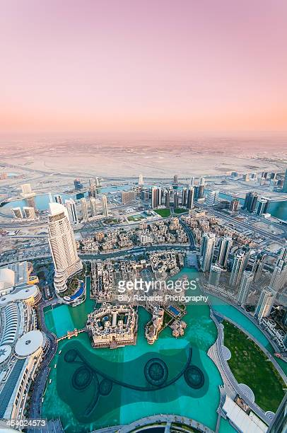 Aerial cityscape with pink sunset