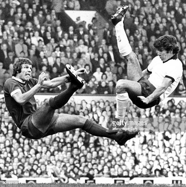 Aerial combat between Toshack of Liverpool and Newton of Derby County