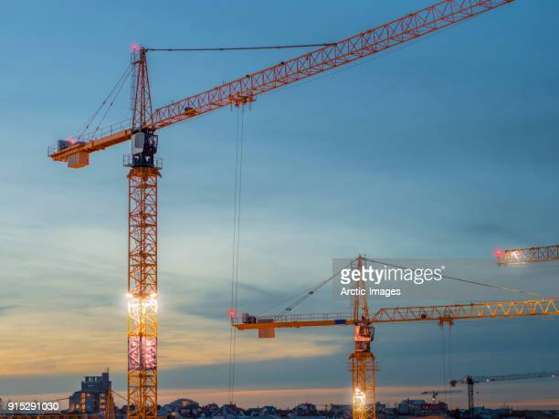 aerial - construction cranes - crane stock pictures, royalty-free photos & images