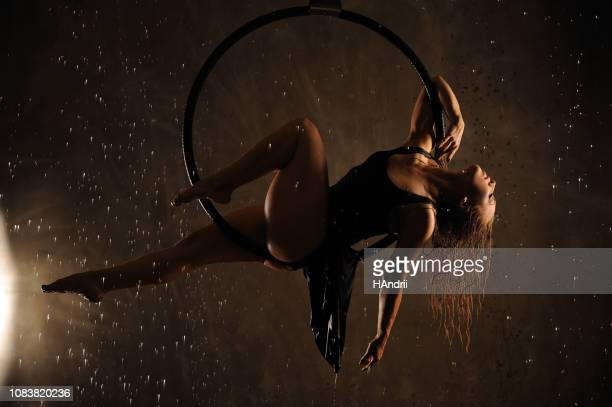 aerial dancer during the rain. - circus stock pictures, royalty-free photos & images