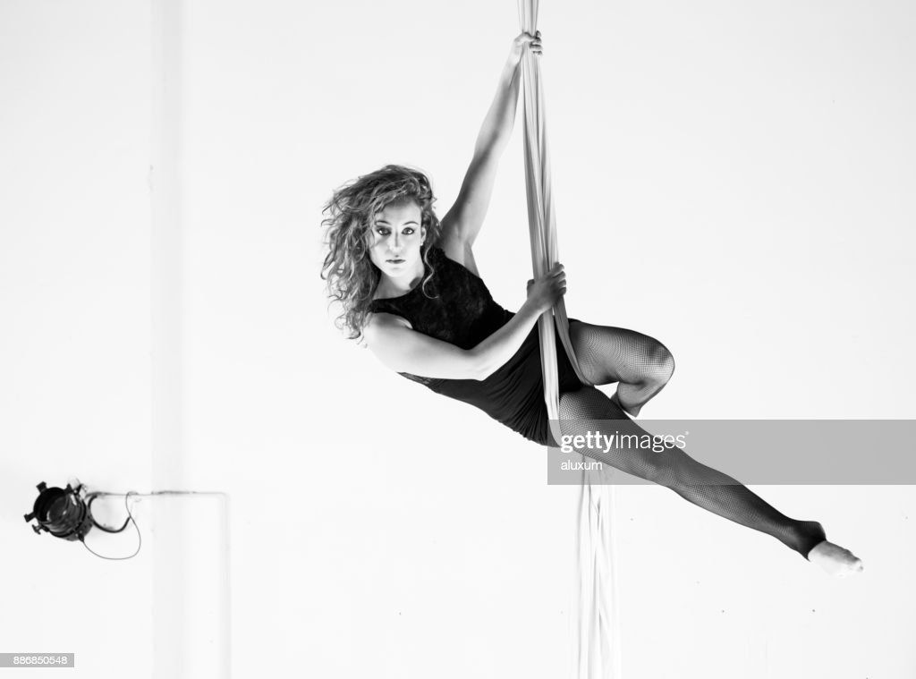 Aerial dancer performance with silks : Stock Photo
