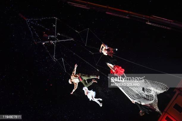 """Aerial dancers from the company of Elisa Barucchieri together with the Fidelio company and the Kai Leclerc company, perform during """"Fellini 100""""..."""