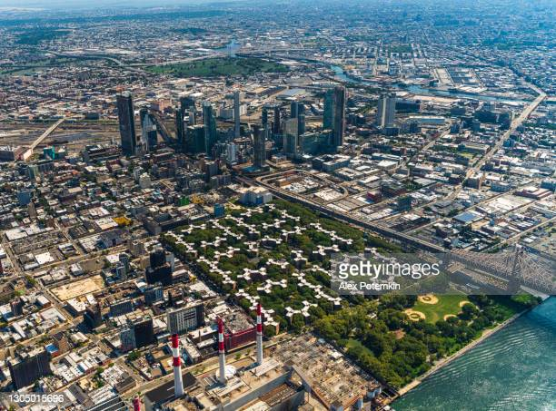 aerial distant view on long island city business and financial district and queensbridge housing project, queens, new york. - queens new york city stock pictures, royalty-free photos & images
