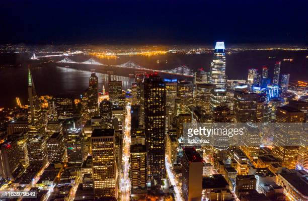 aerial downtown san francisco at twilight - san francisco bay bridge stock pictures, royalty-free photos & images